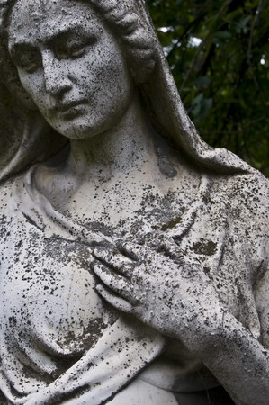 detail of an old marble fombstone at the central cemetery in Vienna photo
