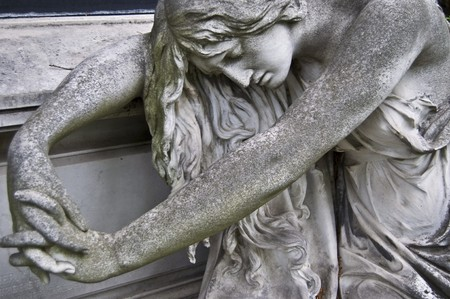angel headstone: detail of an old marble fombstone at the central cemetery in Vienna