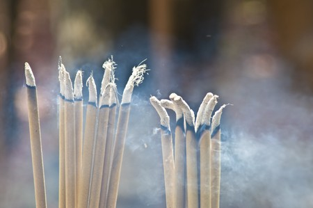incense sticks: burning incense sticks in a thai temple Stock Photo