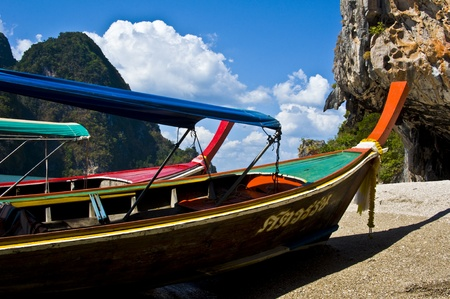 typical thai longboat in the phang nga bay photo