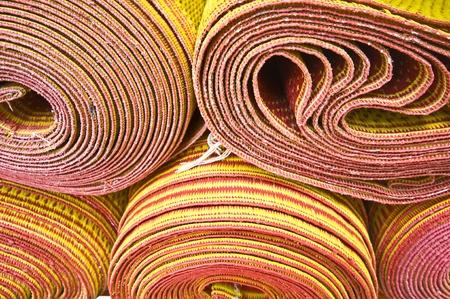 prayer rug: stack of colorful convolved buddhist prayer rugs