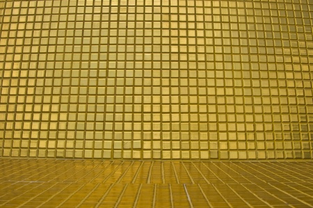 interesting background of many small golden tiles photo