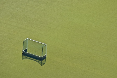 unoccupied: empty goal standing on a grassy playground