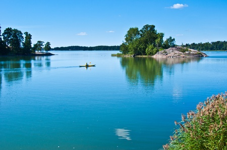 peaceful finnish scenery in Helsinki with a canoe in the distance