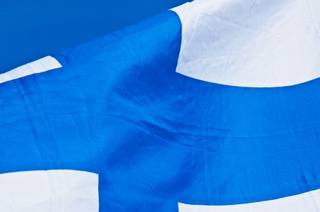 finnish flag fluttering in the wind on a sunny day photo
