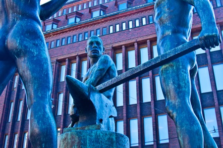 sculpture of the three blacksmiths in Helsinki