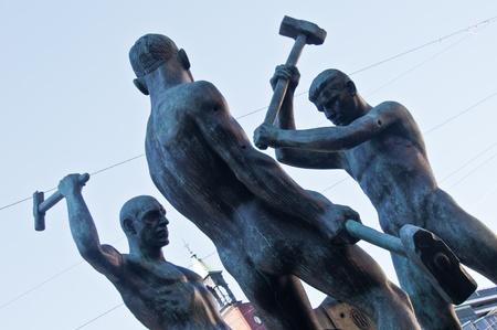 sculpture of the three blacksmiths in Helsinki