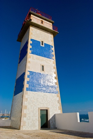 Lighthouse in the harbour of Cascais, Portugal Stock Photo - 13398572