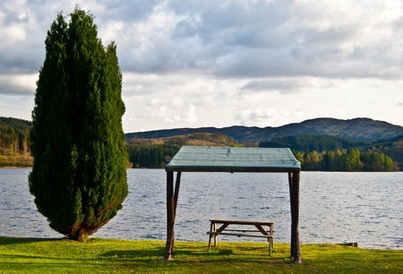 picnic table with a beautiful view over a lake Stock Photo - 13556195