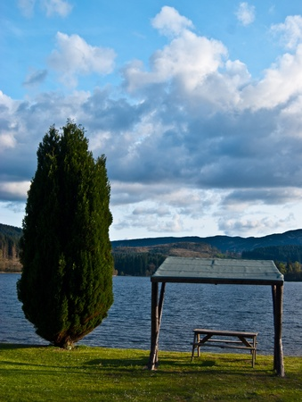 picnic table with a beautiful view over a lake Stock Photo - 13556191