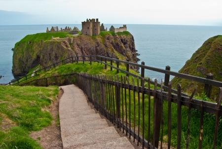 dunnottar castle: famous remotely set Dunnottar castle in Scotland