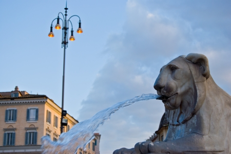 detail of the fountain in the middle of Piazza del Popolo in Rome photo