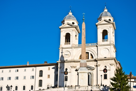 spanish steps: obelisk and church on top of the spanish steps in Rome