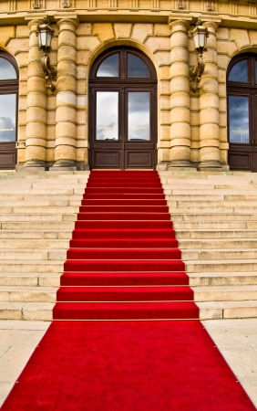 elegant staircase: red carpet leading up the stairs Stock Photo