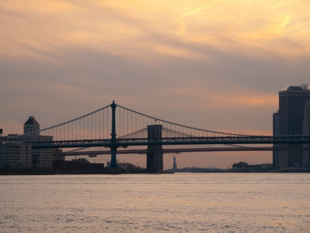 Brooklyn Bridge, Manhattan Bridge and the Statue of Liberty in NYC photo
