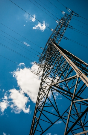 view of a Transmission tower on a sunny day photo
