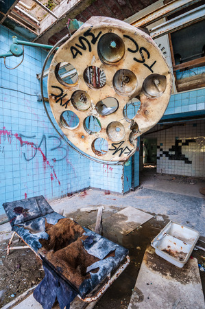 dirty room: dirty operating room in an abandoned hospital Stock Photo