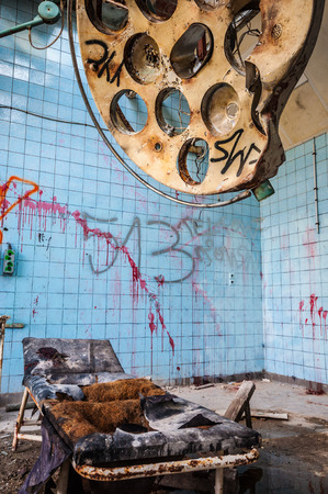 dirty operating room in an abandoned hospital photo