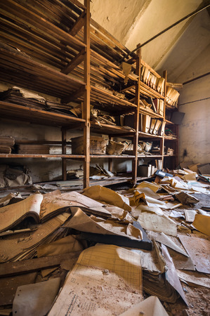 disarray: old forgotten documents in an abandoned building