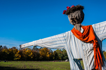 Scarecrow in a field on a sunny day photo
