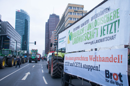 agricultural industry: BERLIN, GERMANY - JANUARY 16: Demonstration Wir haben es satt! against the agricultural industry on January 16, 2016 in Berlin, Germany