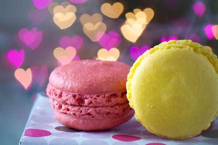 macarons: French Macarons on heart bokeh