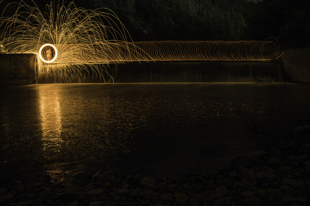 Amazing steel wool burning photo in the lake at the night