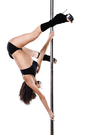 Young sexy woman exercise pole dance against a white background Stock Photo - 9904336
