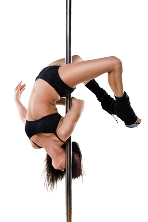Young sexy woman exercise pole dance against a white background Stock Photo - 9904347