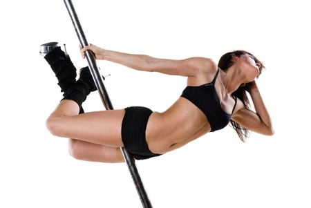 Young sexy woman exercise pole dance against a white background Stock Photo - 9986137
