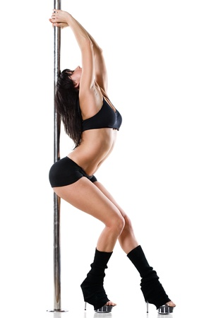 Young sexy woman exercise pole dance against a white background Stock Photo - 9904335