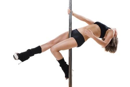 Junge sexy Frau ausüben Pole Dance vor einem weißen Hintergrund Standard-Bild - 9904332