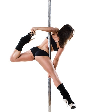 Young sexy woman exercise pole dance against a white background Stock Photo - 9904330