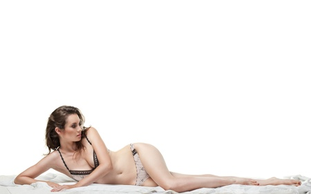 Sexy woman lying on the white bed in lingerie Stock Photo - 9904329