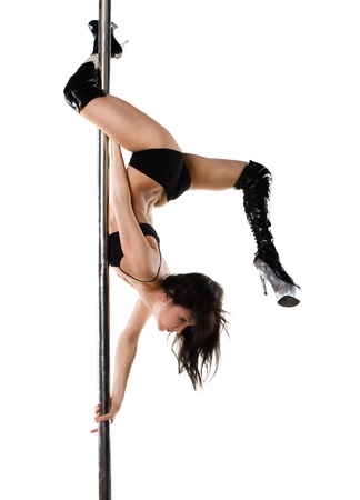 nude gymnast: Young sexy woman exercise pole dance against a white background
