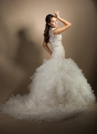 The beautiful young woman posing in a wedding dress Stock Photo