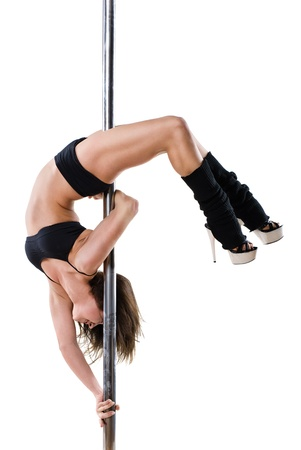 Young sexy woman exercise pole dance against a white background  Stock Photo - 10081181