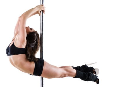Young sexy woman exercise pole dance against a white background  Stock Photo
