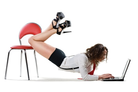sexy businesswoman: sexy young businesswoman lying on chair with laptop, isolated on white Stock Photo