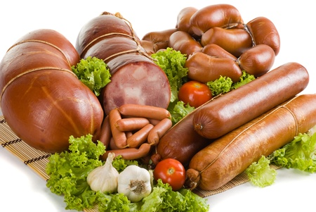 Sausages and ham with lettuce and tomatoes photo