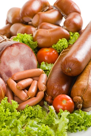 Sausages and ham with lettuce, garlic and tomatoes photo