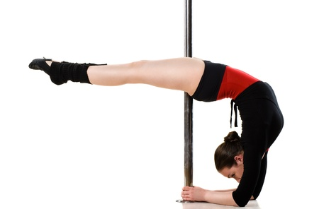 pole dance: Young pole dance woman doing gymnastics against a white background