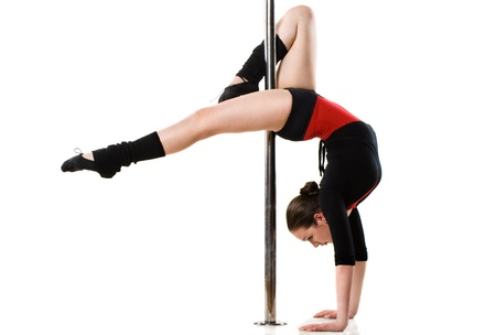 pole dancer: Young pole dance woman doing gymnastics against a white background