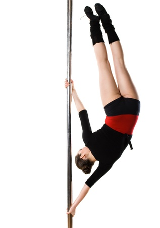 Young pole dance woman doing gymnastics against a white background