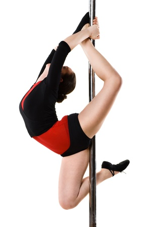poledance: Young pole dance woman doing gymnastics against a white background