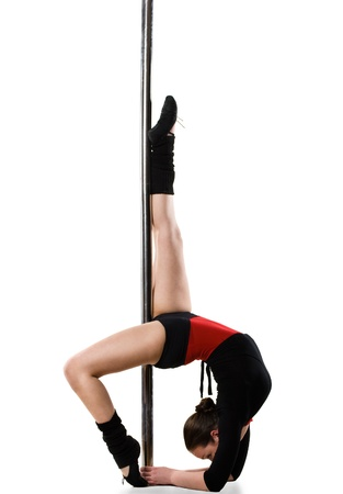Young pole dance woman doing gymnastics against a white background Stock Photo - 10850084