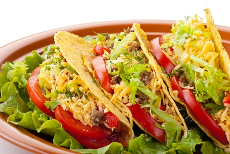 tex mex: Closeup of beef tacos served with salad and fresh tomatoes salsa on white background Stock Photo