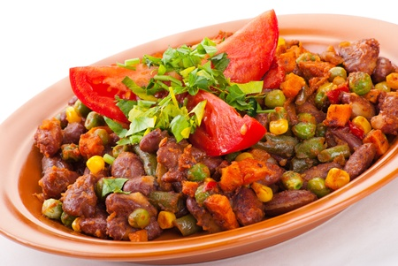 Traditional mexican chili with kidney beans and tomato on white background Standard-Bild