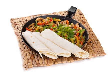 traditional mexican beef fajitas with tortillas on white background photo