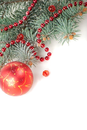 Christmas decorations with branch of Christmas tree on white background photo